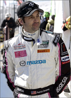 Actor Patrick Dempsey walks along pit road during a practice day at the Rolex 24 Hours of Daytona.