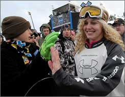 Lindsey Jacobellis makes her way through the crowd to collect her gold medal in Snowboarder X.