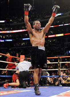 Shane Mosley celebrates after Antonio Margarito's corner threw in the towel in the ninth round of their WBA welterweight title match Saturday in Los Angeles.