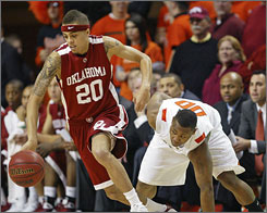 Oklahoma's Austin Johnson, dribbling around Oklahoma State's Byron Eaton during the second half, scored a key three-pointer to help the Sooners knock off their rival Cowboys on the road.