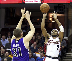 The Cleveland Cavaliers' Mo Williams shoots a three-pointer over the Sacramento Kings' Spencer Hawes during the fourth quarter of their game in Cleveland. Williams scored a career-high 43 points.