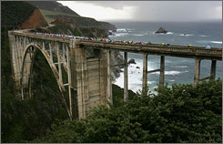Riders cross the Bixby Bridge near Big Sur during the 2007 Tour of California.