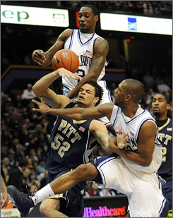Cory Stokes, top, Dwayne Anderson, right, and Villanova knocked off Gary McGhee and third-ranked Pittsburgh in the last college basketball game played in the Spectrum.