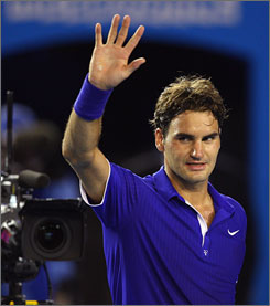 Roger Federer of Switzerland thanks the crowd after winning his semifinal match against Andy Roddick during day 11 of the 2009 Australian Open at Melbourne Park.