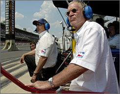 Team owners Bobby Rahal, left, and David Letterman take in the 2006 Indy 500 from Danica Patrick's pit stall.
