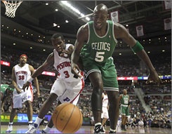 Celtics forward Kevin Garnett, right, and the Pistons' Rodney Stuckey battle for a loose ball in the first quarter of Boston's win in Auburn Hills, Mich.