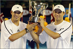 Bob, left, and Mike Bryan celebrate after winning the Australian Open for their seventh Grand Slam title.