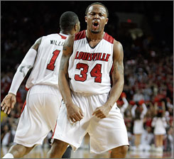 Louisville's Jerry Smith celebrates during the seventh-ranked Cardinals' victory over West Virginia on Saturday at Freedom Hall.
