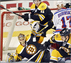 Bruins goalie Tuukka Rask gets low to deflect a shot against the Rangers during the third period. The 21-year-old stopped 35 shots to earn his first NHL shutout.