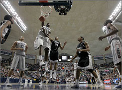 UConn's Hasheem Thabeet throws home two points during the second-ranked Huskies' rout of Providence on Saturday in Storrs, Conn. Thabeet tallied a triple-double in the game as UConn now looks poised to take over the top spot in the USA TODAY/ESPN coaches' poll.