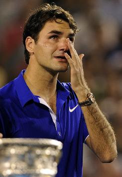 Roger Federer breaks down during the awards ceremony at the Australian Open after his five-set loss to Rafael Nadal.