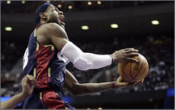 LeBron James soars to the hoop during the first half against the Pistons on the way to a 33-point day.
