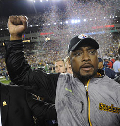 Steelers coach Mike Tomlin celebrates his team's victory over the Arizona Cardinals.