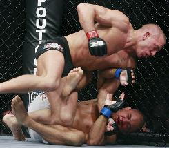 Georges St-Pierre, on top, took down BJ Penn in every round except the first during their welterweight championship bout on Saturday at UFC 94.