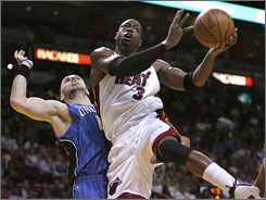 Miami Heat guard Dwyane Wade, right, makes a move against the Orlando Magic in a Jan. 24 game. Wade and the Heat travel to Detroit to take on the Pistons on Wednesday.