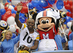 Santonio Holmes earned a trip to Disney World a day after earning Super Bowl MVP honors.