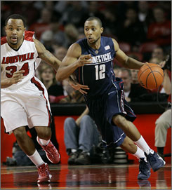A.J. Price, bringing up the ball past Louisville's Jerry Smith during the first half, helped top-ranked Connecticut leave The Bluegrass State victorious.