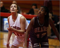 "Lawrence North's Chelsey Miller, left, and Lawrence Central's Taylor Sanders face off in a 49-point North rout that the losing coach called ""our fault as much as theirs."""