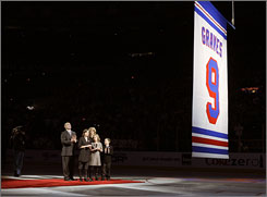 Adam Graves and his family watch as his No. 9 is raised to the Madison Square Garden rafters before the Rangers hosted the Thrashers in New York.