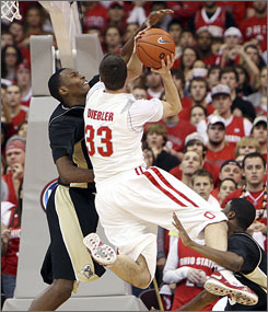 Ohio State's Jon Diebler tries to shoot over Purdue's JaJuan Johnson, left, during the second half of their game in Columbus, Diebler had 10 points and seven assists as the Buckeyes won 80-72 in overtime.