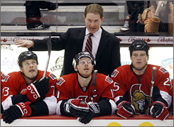 Senators head coach Cory Clouston gives instructions in his first game leading Ottawa after Craig Hartsburg was fired Sunday night.