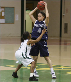 Farmingdale State's Tiffara Steward defends against Polytechnic University's Aranda Consuelo. Steward, at 4-feet-6 and 90 pounds, has learned to contribute on the court.