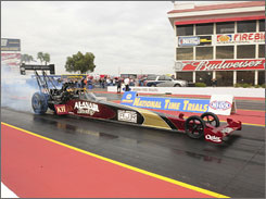 Top Fuel driver Larry Dixon tests his new dragster recently in Chandler, Ariz., for Alan Johnson Al-Anabi Racing, a new team owned by Johnson and Sheik Khalid Bin Hamad Al-Thani of Qatar.