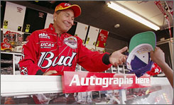 Kenny Bernstein, signing an autograph for a fan in 2002, has had Anheuser-Busch behind his racing efforts for 30 years.