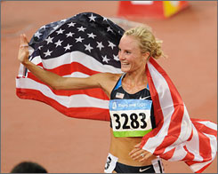 Shalane Flanagan celebrates her bronze medal win in the 10,000 meters at the Beijing Olympics in 2008. She's trying for a U.S. record in the 5,000 meters this weekend in Boston.