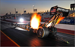 Top Fuel champ Tony Schumacher launches off the starting line at Firebird International Raceway on the way to a 1,000-foot run during preseason testing.