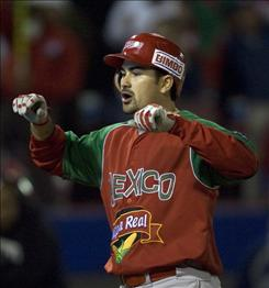Mexico`s Mazatlan Venados first baseman Adrian Gonzalez celebrate the first of three home runs Wednesday against Dominican Republic`s Licey Tigres during a Caribbean Series in Mexicali, Mexico.