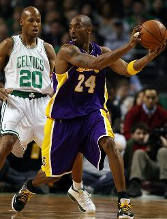 The Lakers' Kobe Bryant shields the ball away from the Celtics' Ray Allen, as Los Angeles downed Boston 110-109.