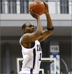 Xavier Musketeers forward B.J. Raymond shoots a three-pointer during the second half of the game against the Temple Owls. Raymond was 5-of-7 from behind the arc and scored 24 points.