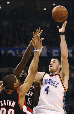 Oklahoma City forward Nick Collison, right, shoots over Portland forward Nicolas Batum, left, and center Greg Oden during the first quarter of their game in Oklahoma City. Collison finished with 21 points and 13 rebounds.
