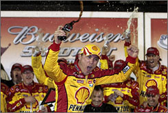 Kevin Harvick celebrates with his crew after winning the NASCAR Sprint Cup Budweiser Shootout at Daytona International Raceway. Harvick passed Jamie McMurray on the last lap to win the race.