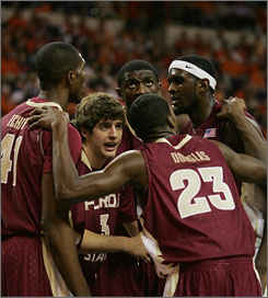 Seminoles guard Luke Loucks leads the huddle before a free throw attempt in the first half against Clemson.