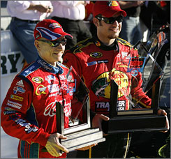 Fastest qualifier Martin Truex Jr., right, and second-fastest Mark Martin show off their hardware for sealing front-row starting spots for the Daytona 500.