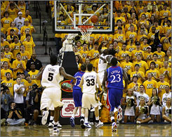 Missouri's DeMarre Carroll (1) scores on a fast-break layup against Kansas during their game in Columbia, Mo. No. 19 Missouri rallied from a 14-point deficit to shock the No. 16 Jayhawks 62-60.