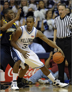 Marquette's Dwight Burke, right, attempts to defend against Villanova forward Dante Cunningham.