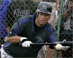 Former baseball All-Star Roberto Alomar was named in a lawsuit filed by an ex-girlfriend on Wednesday.