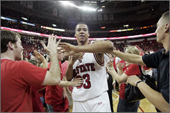North Carolina State forward Brandon Costner celebrates with fans after upsetting No. 8 Wake Forest 82-76 in Raleigh, N.C. Costner scored 23 points to lead the Wolfpack.