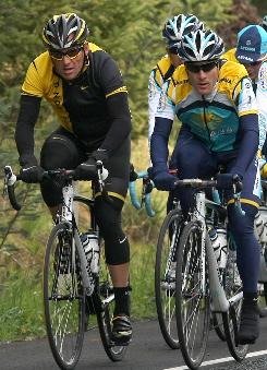 Lance Armstrong, left, trains with Levi Leipheimer in preparation for the Tour of California.
