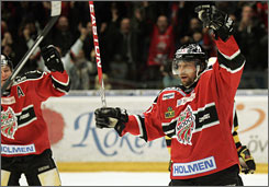 Former NHL star Peter Forsberg celebrates scoring a goal in his first game back with his hometown team in Sweden.