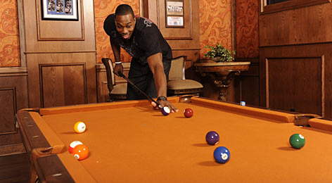 "Dwight Howard takes a break with a game of billiards at his Orlando home. His playful nature has worn off on teammates. Says Orlando guard Jameer Nelson: ""He's going to make you have fun, no matter what type of day you have."""