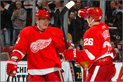 The Red Wings' Jiri Hudler, right celebrates his goal against the Minnesota Wild with teammate Marian Hossa during their NHL game in Detroit.