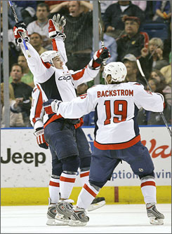 The Capitals' Mike Green, celebrating with teammate Nicklas Backstrom, set an NHL record for defensemen by a scoring a goal in his eighth consecutive game.