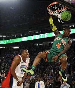 Knicks guard       Nate Robinson elevates to clear the 6-foot-11 height of Magic center       Dwight Howard during the NBA's annual slam dunk contest.