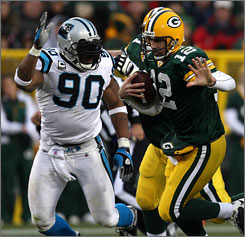 Julius Peppers had sacks in 2008, including this two against Green Bay quarterback Aaron Rodgers.