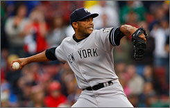 Mariano Rivera, shown here pitching against the Red Sox in Boston last year, will begin his 15th season with the New York Yankees. The star closer had a bone spur removed from his shoulder in the offseason, but says he's ready for opening day.