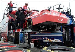 Tony Stewart's crew unloads a reserve No. 14 Chevy after Stewart's primary car was damaged.